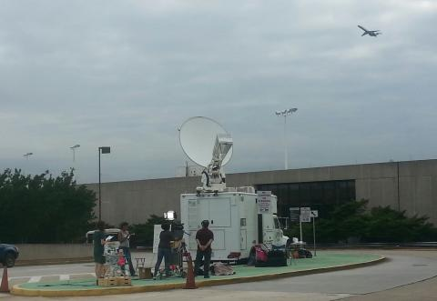 Satellite truck uplink at worlds busiest airport - 2014